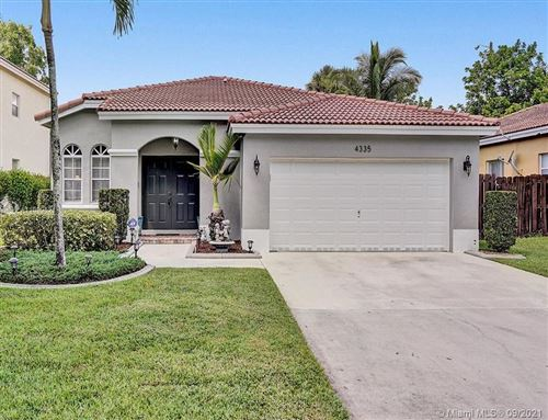 Photo of 4335 NW 45th Ter, Coconut Creek, FL 33073 (MLS # A11099521)