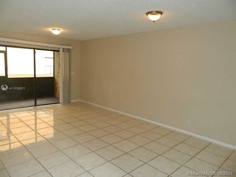 Photo of 2481 NW 56th Ave #9-16, Lauderhill, FL 33313 (MLS # A11039521)