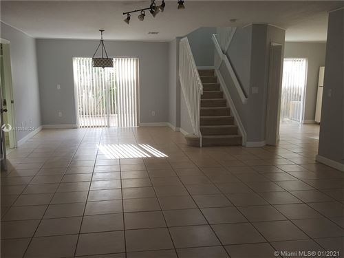 Photo of 7291 NW 173rd Dr #102, Miami, FL 33015 (MLS # A10984524)