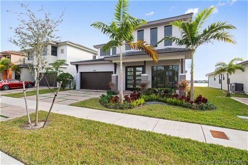 Photo of 8940 NW 160th Ter, Miami Lakes, FL 33018 (MLS # A10986524)