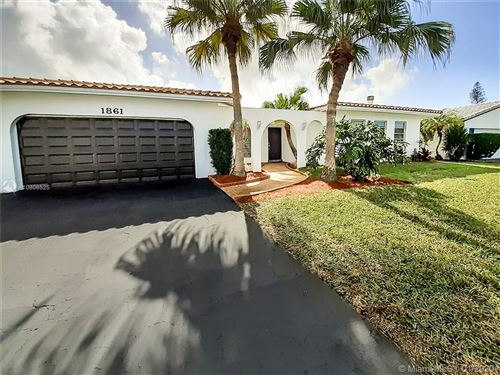 Photo of 1861 NW 83rd Dr, Coral Springs, FL 33071 (MLS # A10806525)