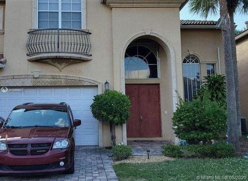 Photo of 10229 Isle Wynd Ct, Boynton Beach, FL 33437 (MLS # A10865527)