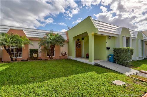 Photo of 7411 Twin Sabal Dr, Miami Lakes, FL 33014 (MLS # A10886527)