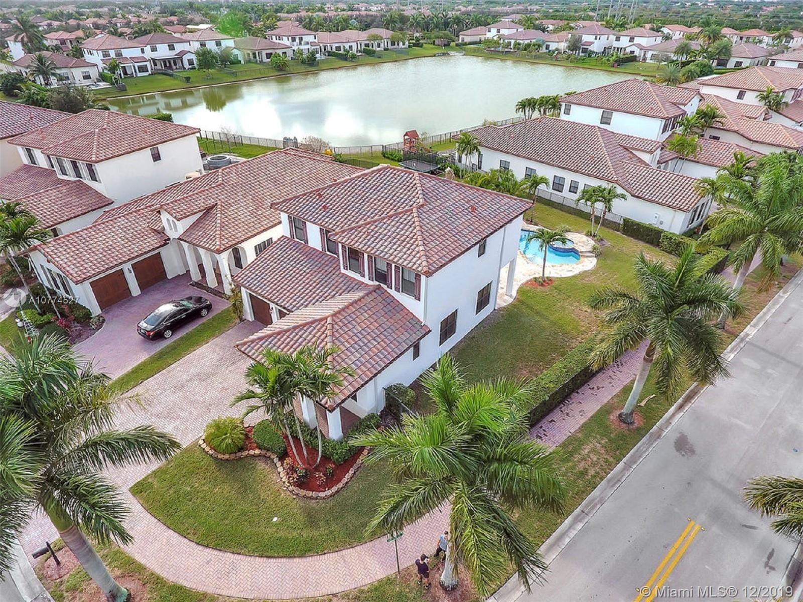 Photo of 3992 NW 82nd Way, Cooper City, FL 33024 (MLS # A10774527)