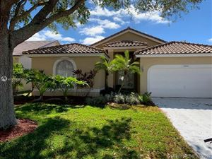 Photo of 5964 NW 74th St, Parkland, FL 33067 (MLS # A10619528)