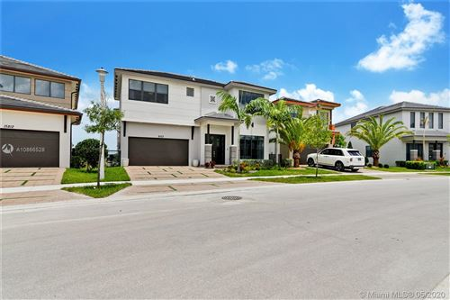 Photo of 8723 NW 159th St, Miami Lakes, FL 33018 (MLS # A10866528)
