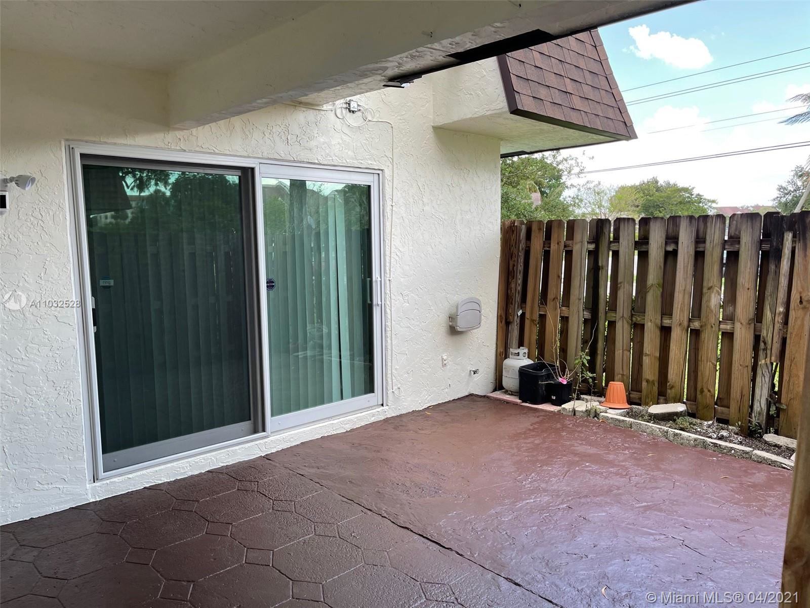 Photo of 7913 Tam Oshanter Blvd, North Lauderdale, FL 33068 (MLS # A11032528)