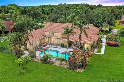 Photo of 13501 SW 34th Ct, Davie, FL 33330 (MLS # A10884529)