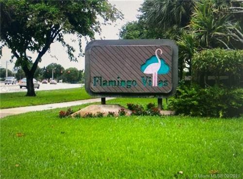 Photo of 1311 NW 122nd Ter #1311, Pembroke Pines, FL 33026 (MLS # A11096531)