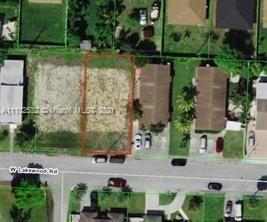 Photo of 1037 W Lakewood Rd, West Palm Beach, FL 33405 (MLS # A11102532)