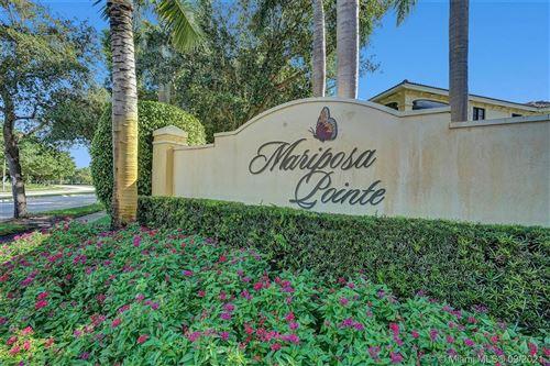 Photo of 1554 Passion Vine Cir #26-1, Weston, FL 33326 (MLS # A11100533)