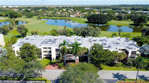 Photo of 16251 NW Golf Club Rd #201, Weston, FL 33326 (MLS # A11104533)