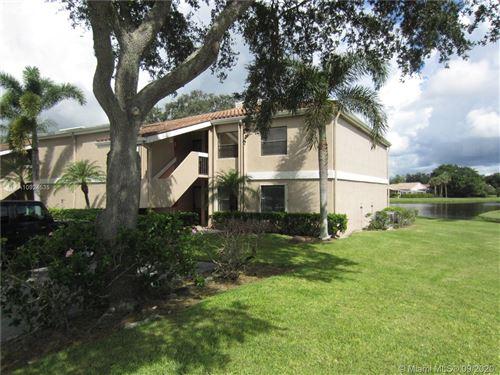 Photo of 6962 Briarlake Cir #J-104, West Palm Beach, FL 33418 (MLS # A10924535)