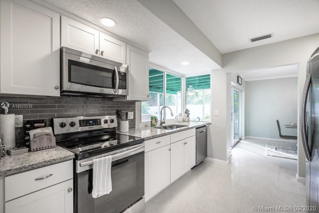 Photo of 520 SE 8th Ave, Deerfield Beach, FL 33441 (MLS # A10925538)