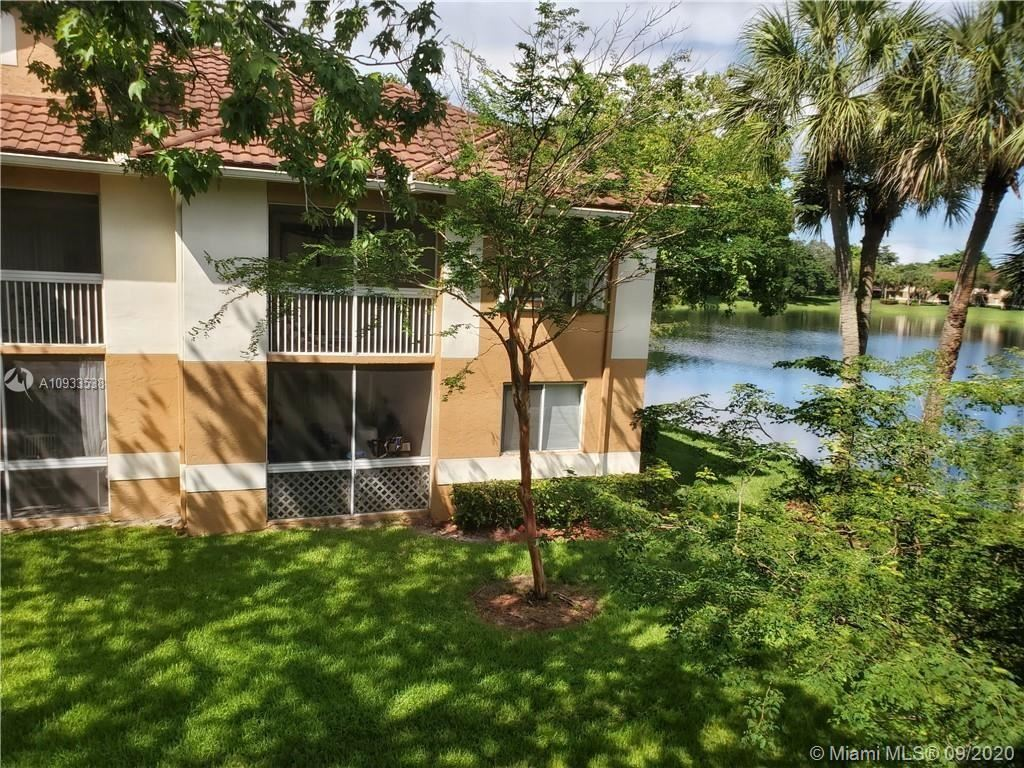 Photo of 802 NW 92nd Ave #802, Plantation, FL 33324 (MLS # A10933538)