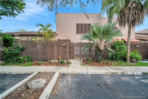 Photo of 1255 NW 122nd Ter, Pembroke Pines, FL 33026 (MLS # A11096539)