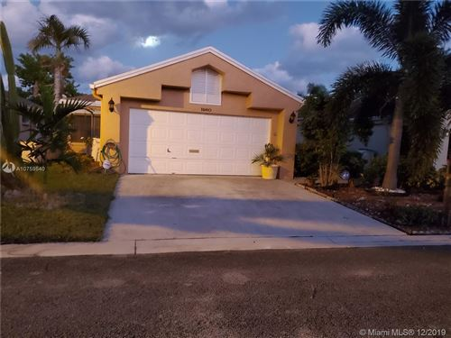 Photo of 1960 NW 39th Ave, Coconut Creek, FL 33066 (MLS # A10759540)