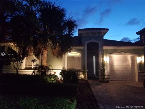 Photo of 20710 SW 90th Pl, Cutler Bay, FL 33189 (MLS # A11092541)