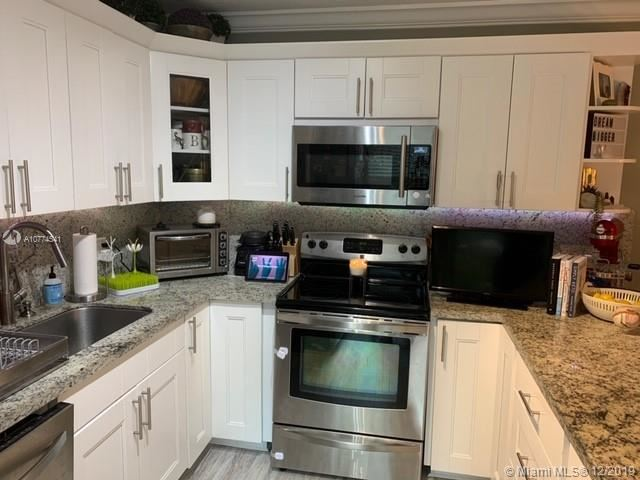 Photo of 2553 Lakeview Ct #232, Cooper City, FL 33026 (MLS # A10774541)