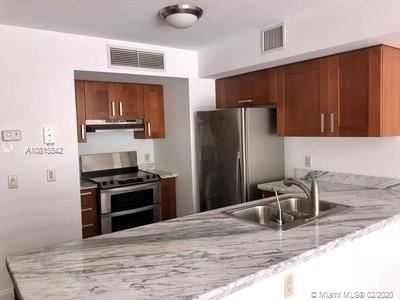Photo of 9499 Collins Ave #1007, Surfside, FL 33154 (MLS # A10815542)