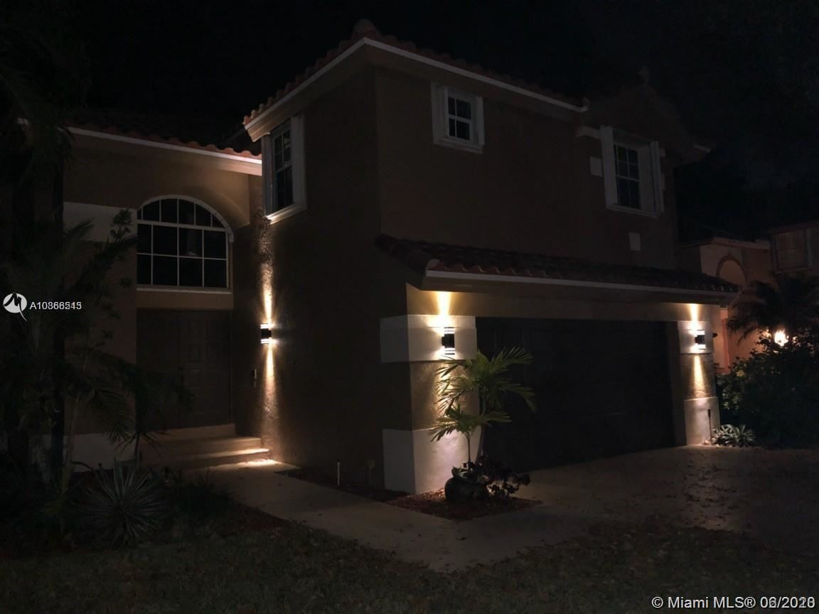 Photo of 11115 Bismarck Pl #0, Cooper City, FL 33026 (MLS # A10868543)