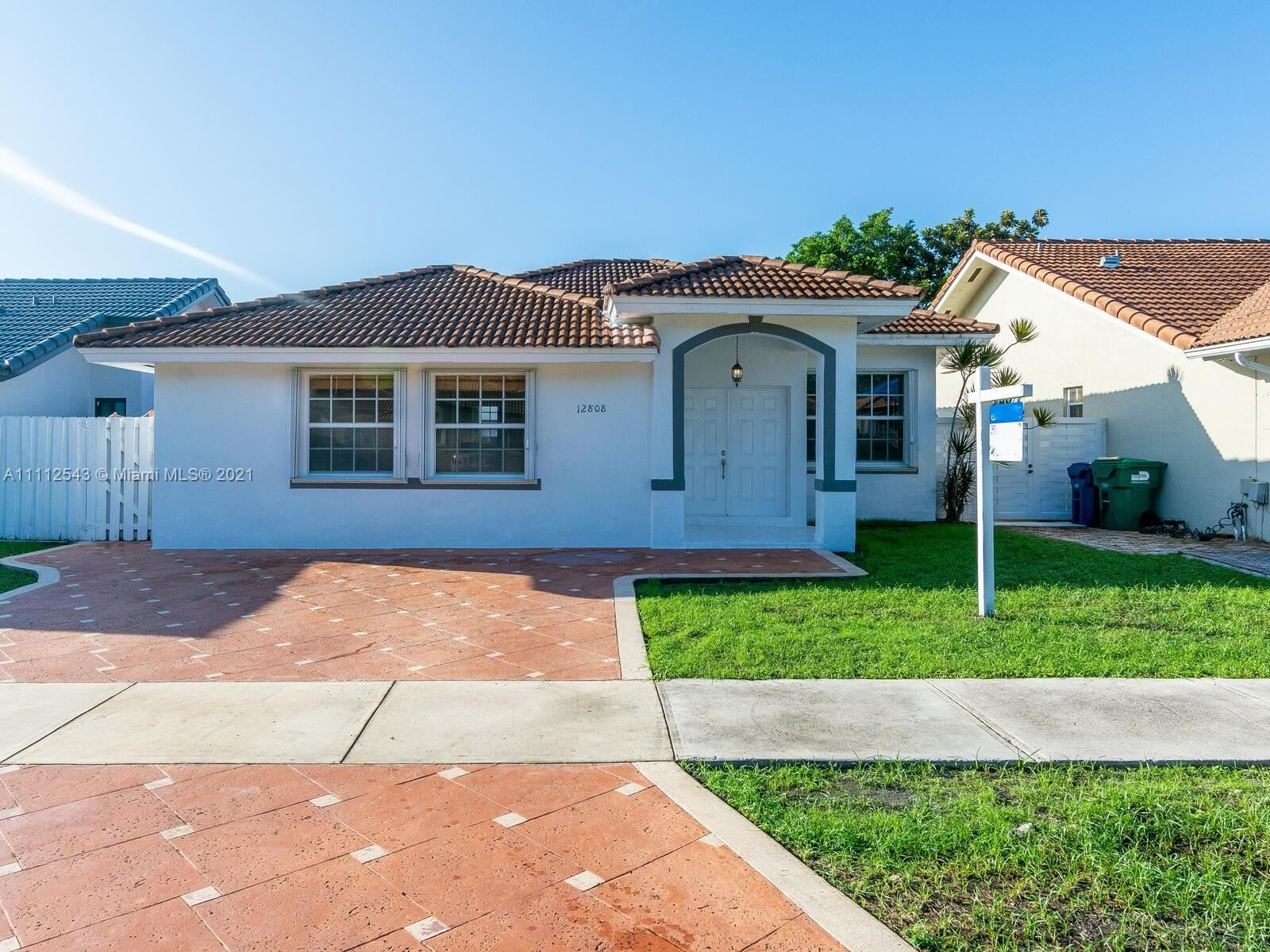 Photo of 12808 NW 11th Ter, Miami, FL 33182 (MLS # A11112543)