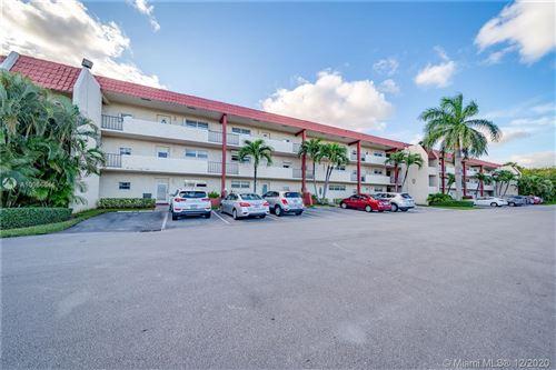 Photo of 8901 S Hollybrook Blvd #304, Pembroke Pines, FL 33025 (MLS # A10966546)