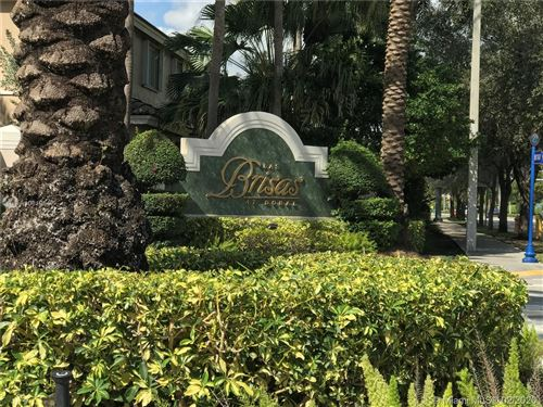 Photo of 5670 NW 116th Ave #208, Doral, FL 33178 (MLS # A10819547)