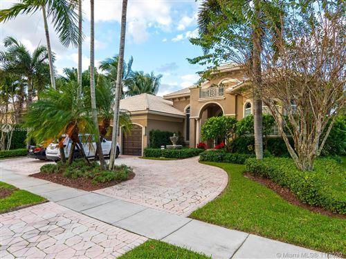 Photo of 11075 Blue Palm St, Plantation, FL 33324 (MLS # A10932549)