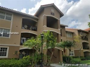 Photo of 100 SW 117th Ter #104, Pembroke Pines, FL 33025 (MLS # A10902552)