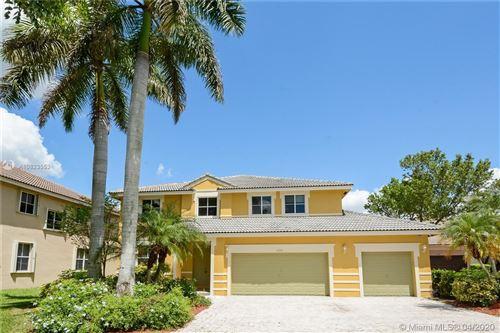 Photo of 1296 Peregrine Way, Weston, FL 33327 (MLS # A10823553)
