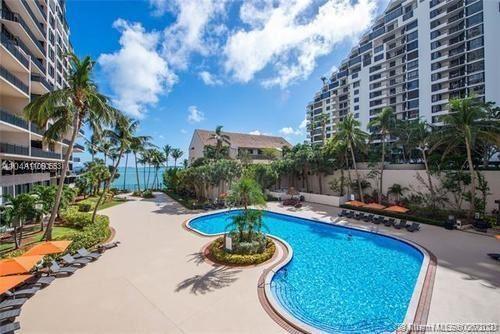Photo of 540 Brickell Key Dr #1802, Miami, FL 33131 (MLS # A11060553)
