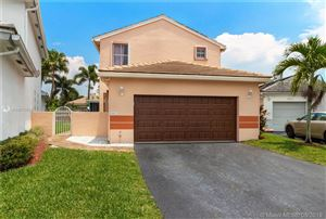 Photo of 18821 NW 22nd St, Pembroke Pines, FL 33029 (MLS # A10673554)