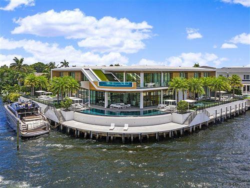 Photo of 819 Orchid Dr, Boca Raton, FL 33432 (MLS # A10979558)