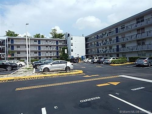 Photo of 14155 SW 87th St #E107, Miami, FL 33183 (MLS # A10863560)