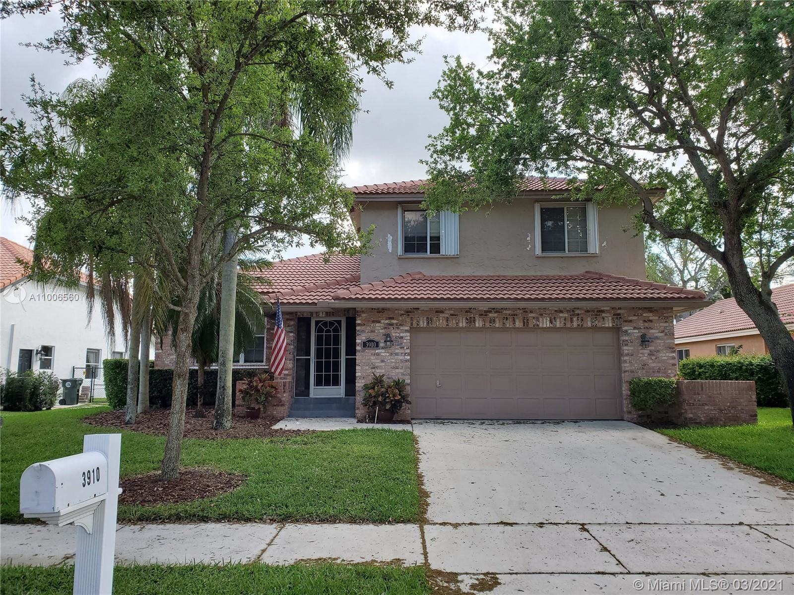 Photo of 3910 NW 54th Ct, Coconut Creek, FL 33073 (MLS # A11006560)