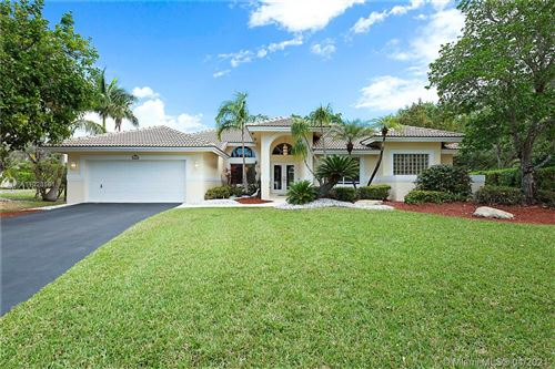Photo of 4905 NW 105th Dr, Coral Springs, FL 33076 (MLS # A11023561)