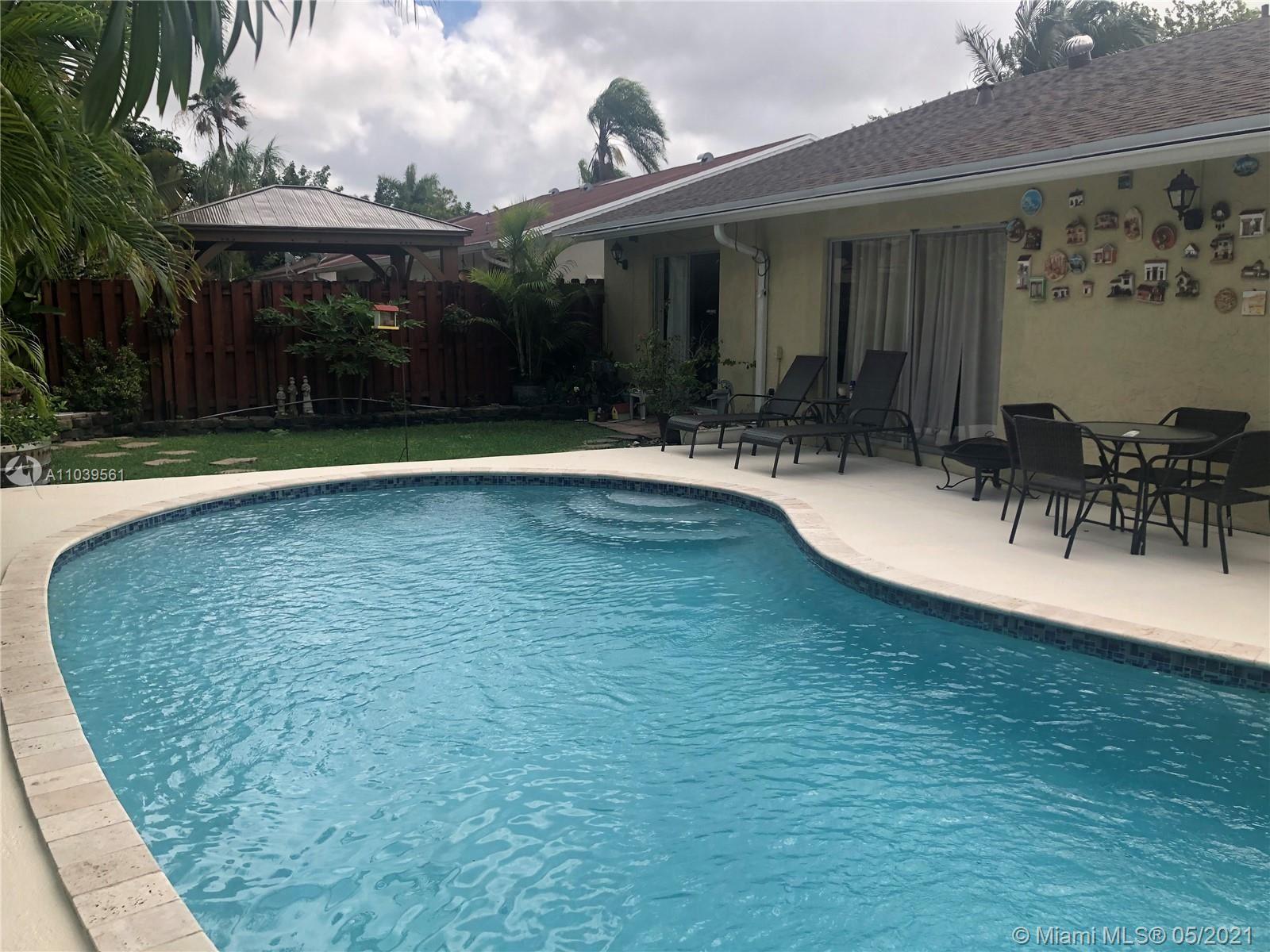 Photo of 10115 SW 144th Pl, Miami, FL 33186 (MLS # A11039561)
