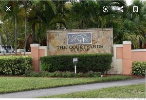 Photo of 6968 SW 39th St #F103, Davie, FL 33314 (MLS # A10757562)