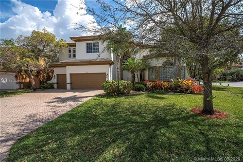 Photo of 6556 NW 127th Ter, Parkland, FL 33076 (MLS # A10829564)