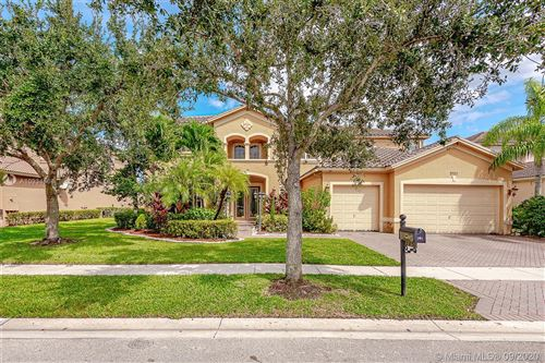 Photo of 3752 W Coquina Way, Weston, FL 33332 (MLS # A10934566)