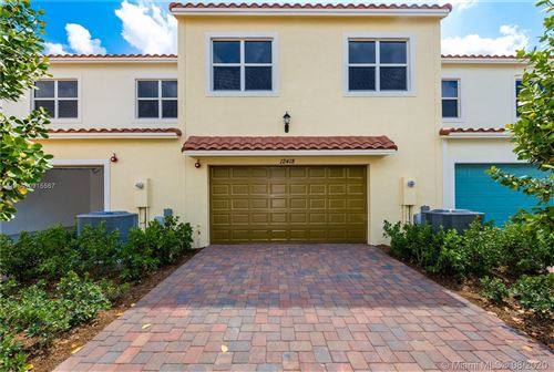 Photo of 12418 NW 17th Ct #12418, Pembroke Pines, FL 33028 (MLS # A10915567)