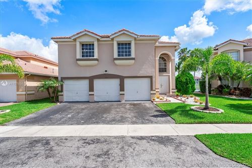 Photo of 153 Granada Ave, Weston, FL 33326 (MLS # A11076567)