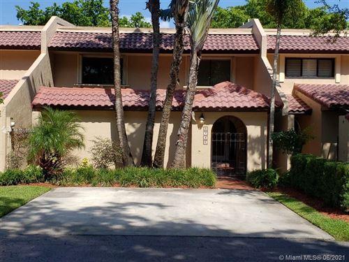 Photo of 3746 NW Alcantara Ave #70-D, Doral, FL 33178 (MLS # A11059569)