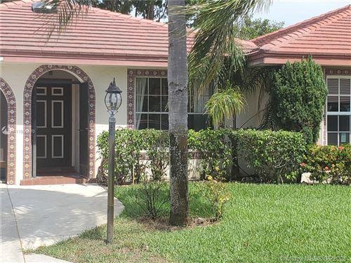 Photo of 1452 SW 26th Ave #A, Boynton Beach, FL 33426 (MLS # A11035570)