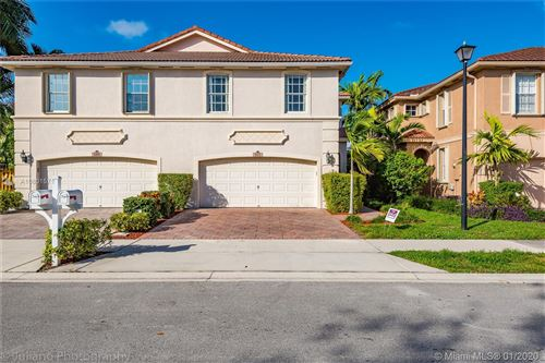 Photo of 5175 Stagecoach Dr, Coconut Creek, FL 33073 (MLS # A10801571)