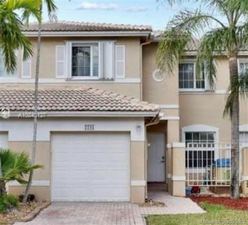 Photo of 2241 NW 170th Ave, Pembroke Pines, FL 33028 (MLS # A10927573)