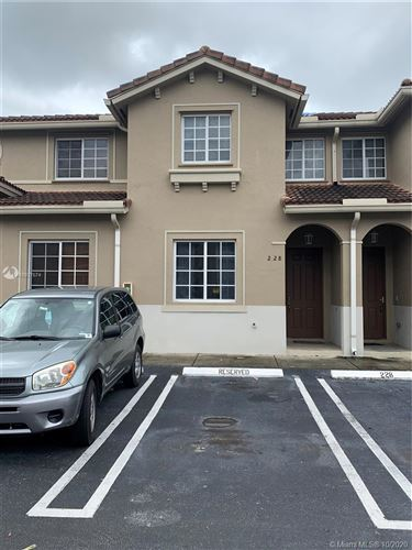 Photo of 21207 NW 14th Pl #2-28, Miami Gardens, FL 33169 (MLS # A10937574)