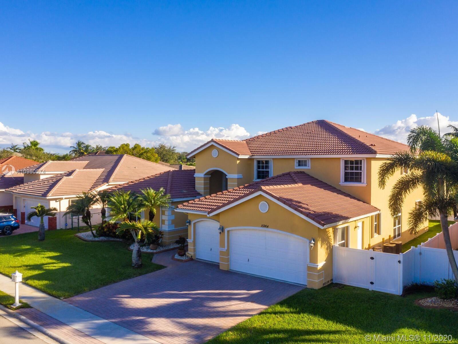 Photo of 15964 SW 4th St, Pembroke Pines, FL 33027 (MLS # A10960574)
