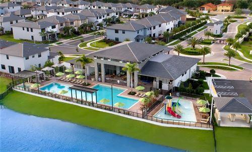 Photo of 9155 NW 161st St #9155, Miami Lakes, FL 33018 (MLS # A11112575)